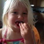 Happy Child with Cherries
